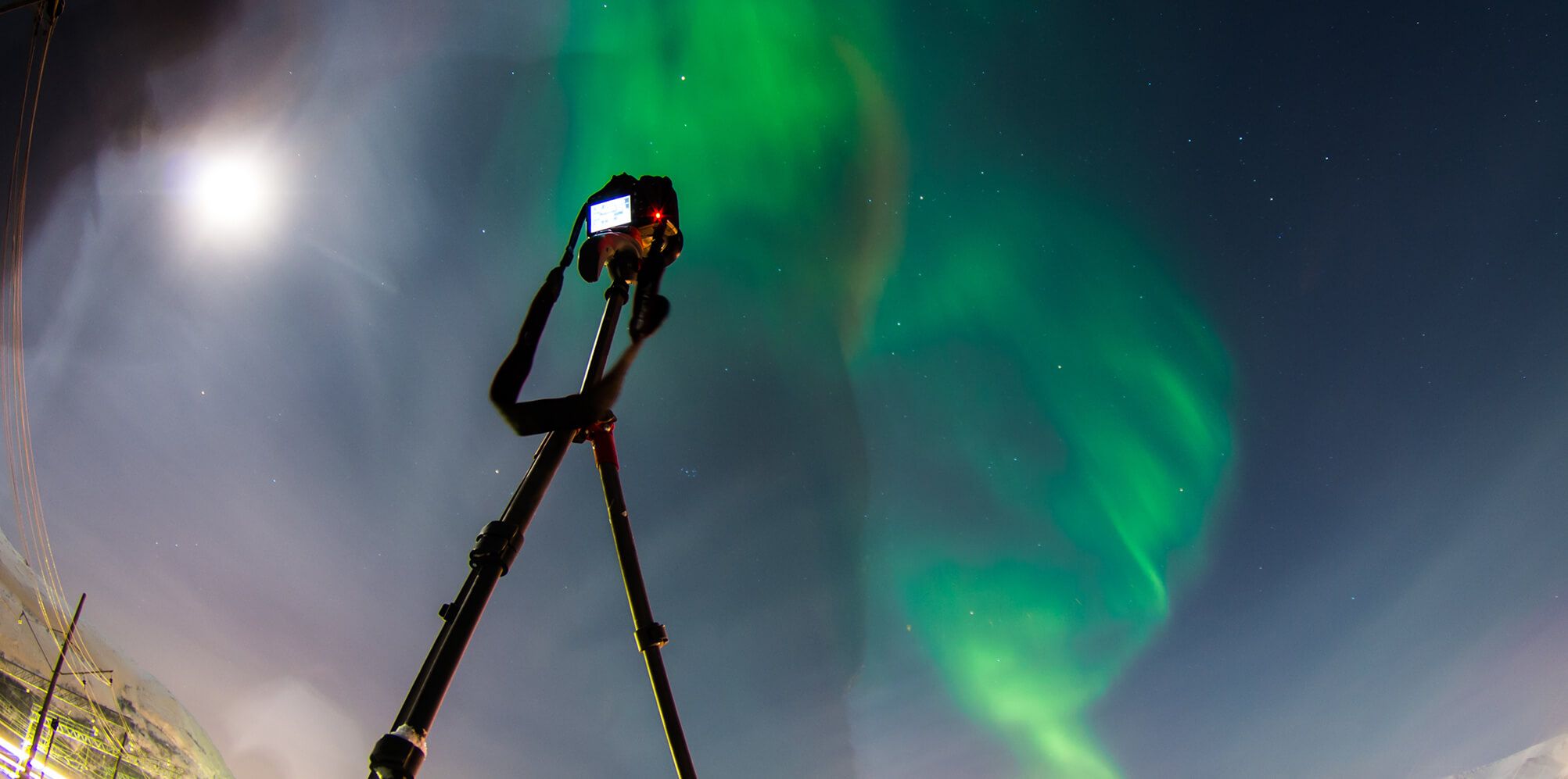 Camera on a tripod pointing up towards the night sky